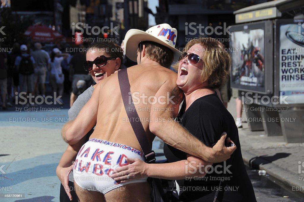 Naked Cowboy, Robert John Burck, and Tourists, New York royalty-free stock photo