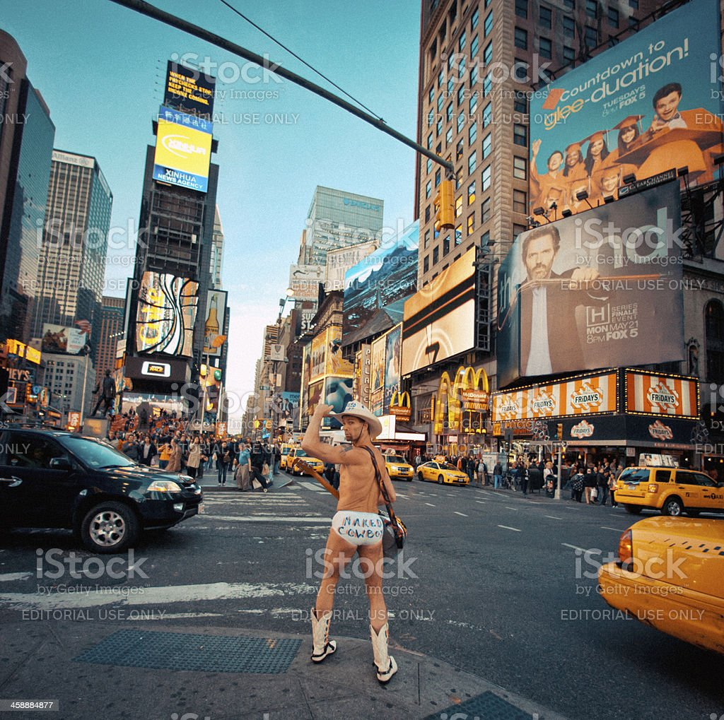 Naked Cowboy showing muscles on Times Square, New York royalty-free stock photo