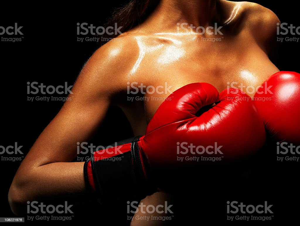 Naked Female Boxer Covering Breasts with Hands royalty-free stock photo