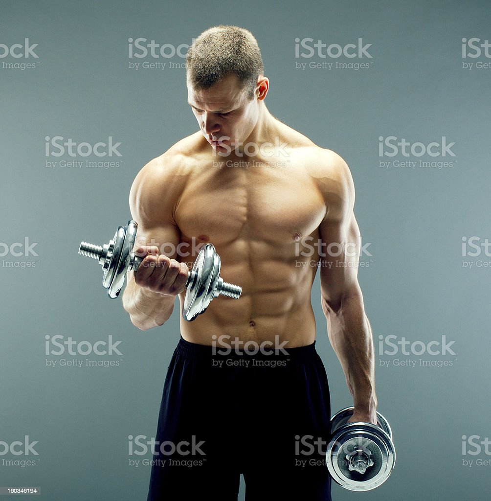 Naked fitness guy in black shorts royalty-free stock photo