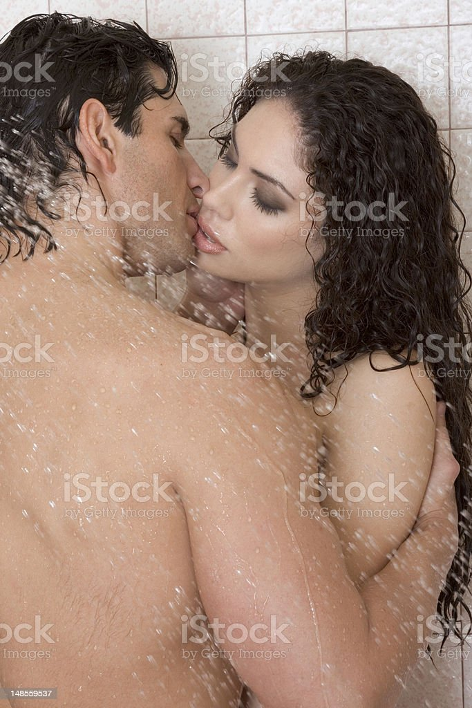 naked Man and woman in love are kissing under shower royalty-free stock photo