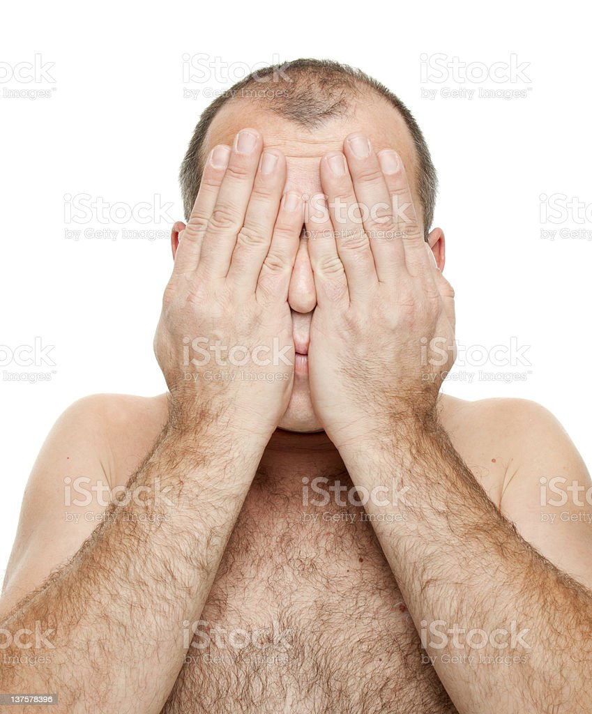 Naked man covering his face royalty-free stock photo