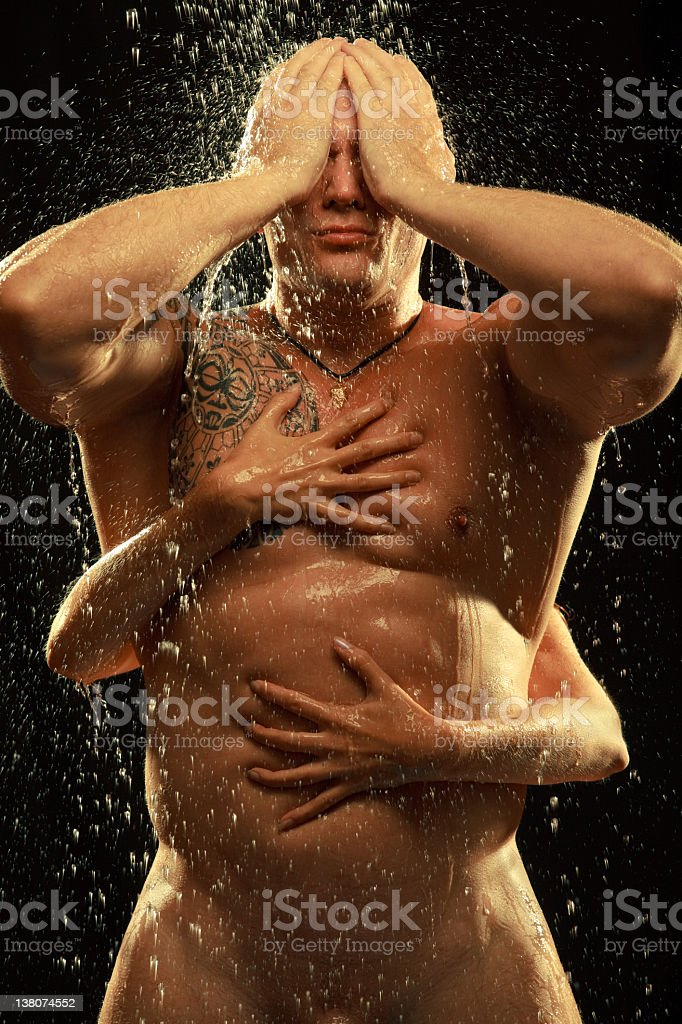 Naked man standing in the rain royalty-free stock photo