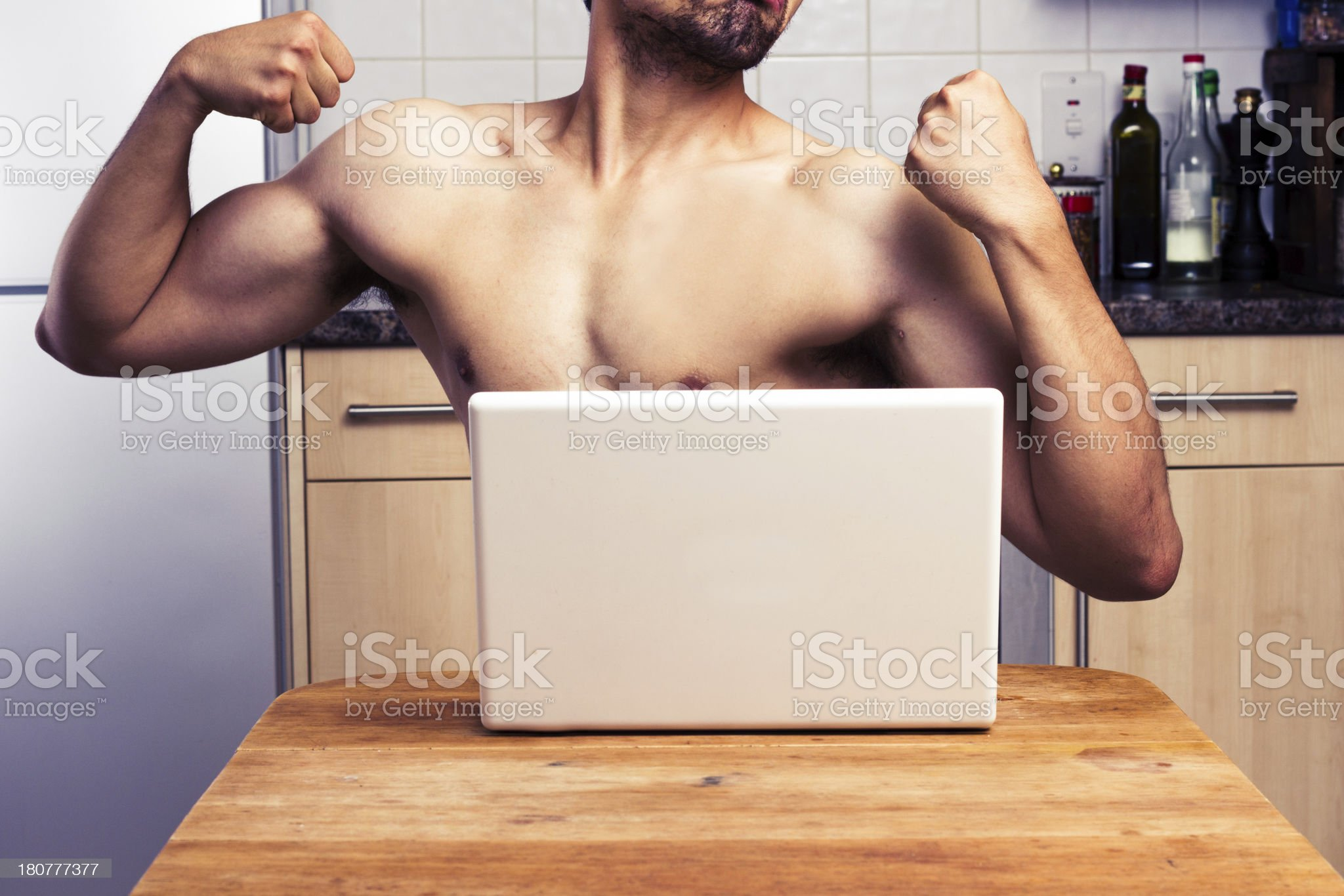 Naked man trying to impress during webcam chat royalty-free stock photo
