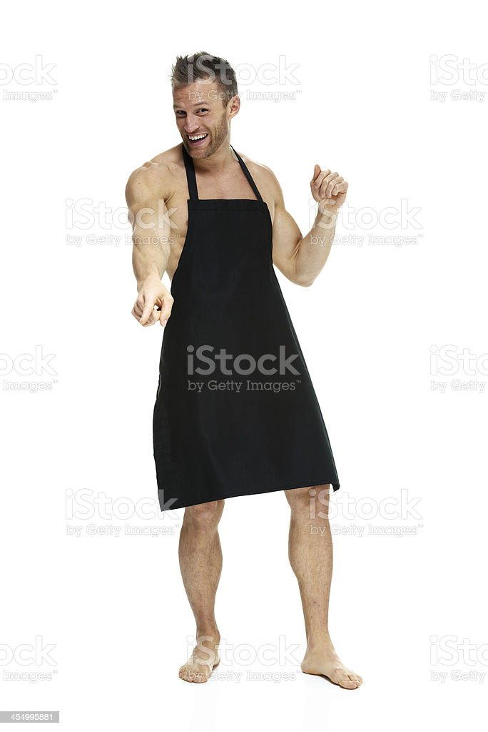 Naked man wearing only an apron royalty-free stock photo