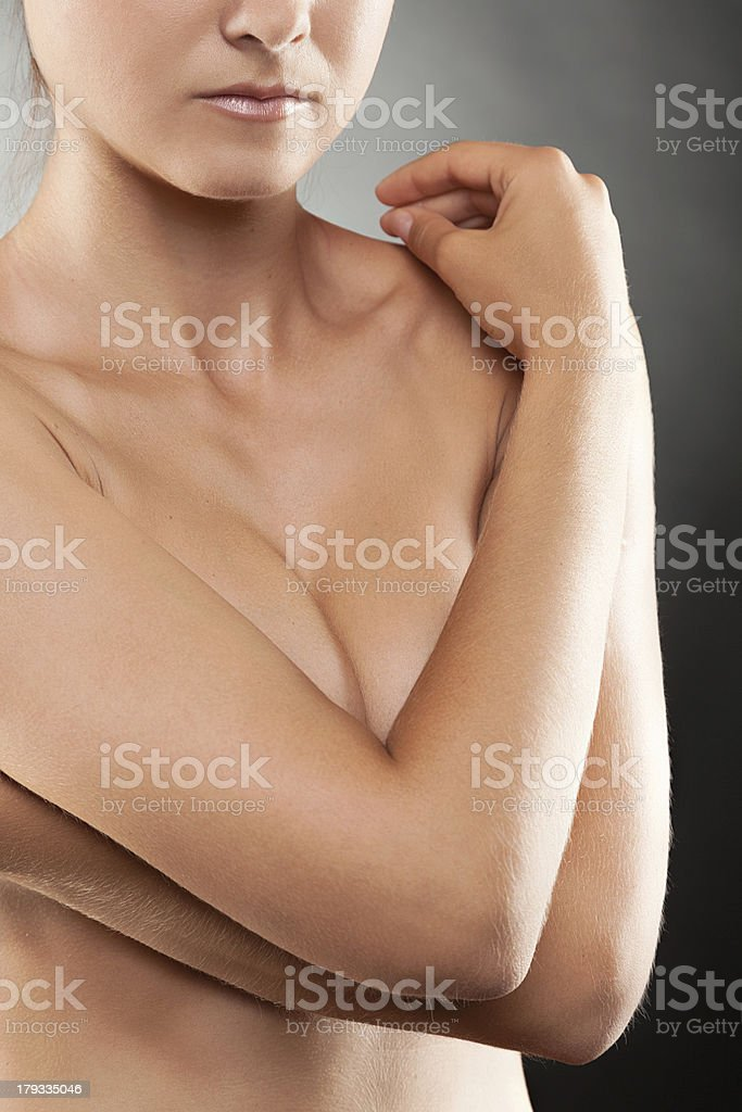 Naked woman covering her breast stock photo