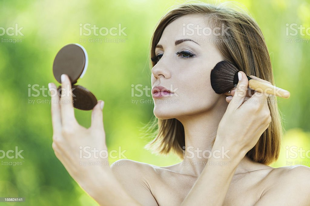 naked woman looks mirror royalty-free stock photo