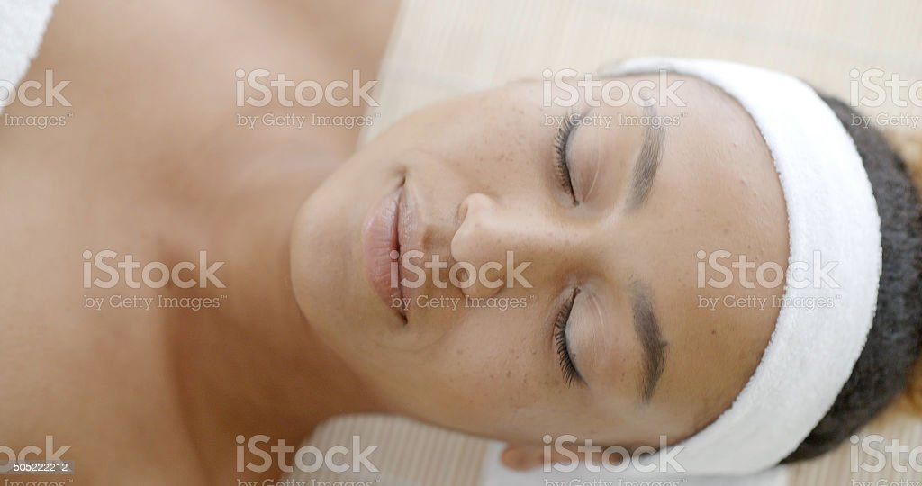 Naked Woman Lying On A Massage Table stock photo