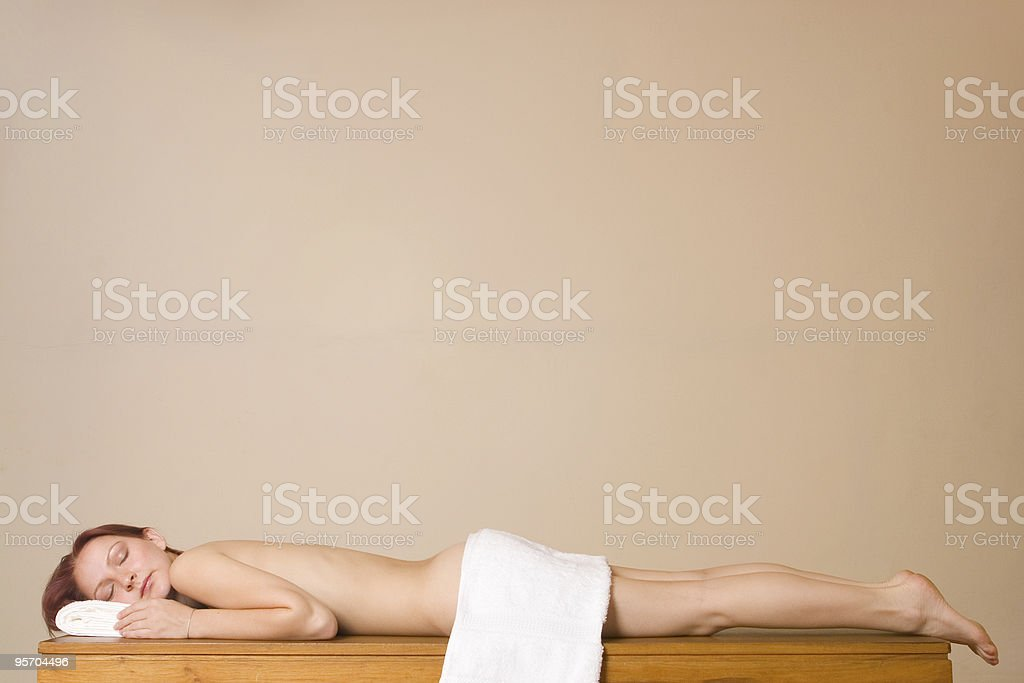 Naked woman on a massage table royalty-free stock photo