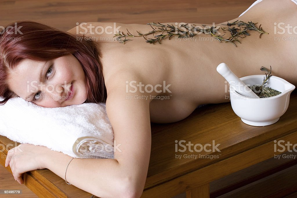 Naked woman on massage table stock photo