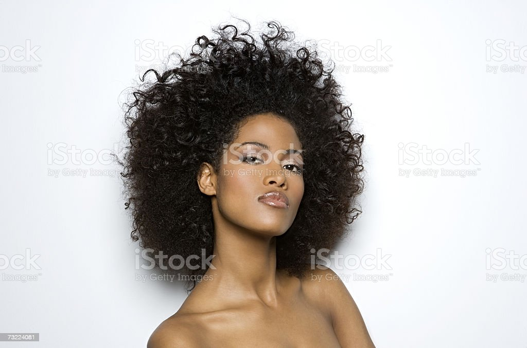 Naked woman standing against white background, portrait, close-up royalty-free stock photo