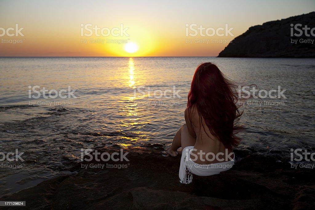 Naked woman watching sunrise royalty-free stock photo