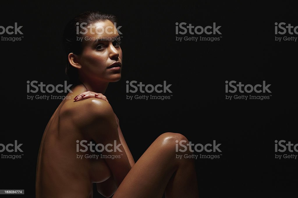 Naked young female isolated against black background royalty-free stock photo
