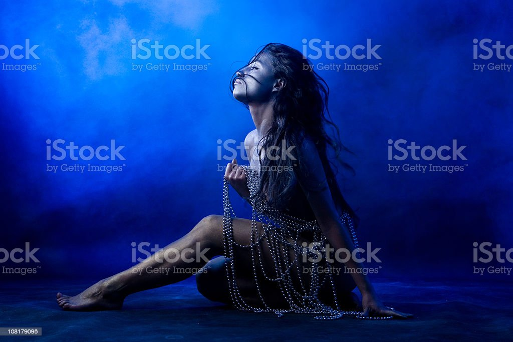 Naked Young Woman Holding Beaded Necklaces Posing royalty-free stock photo