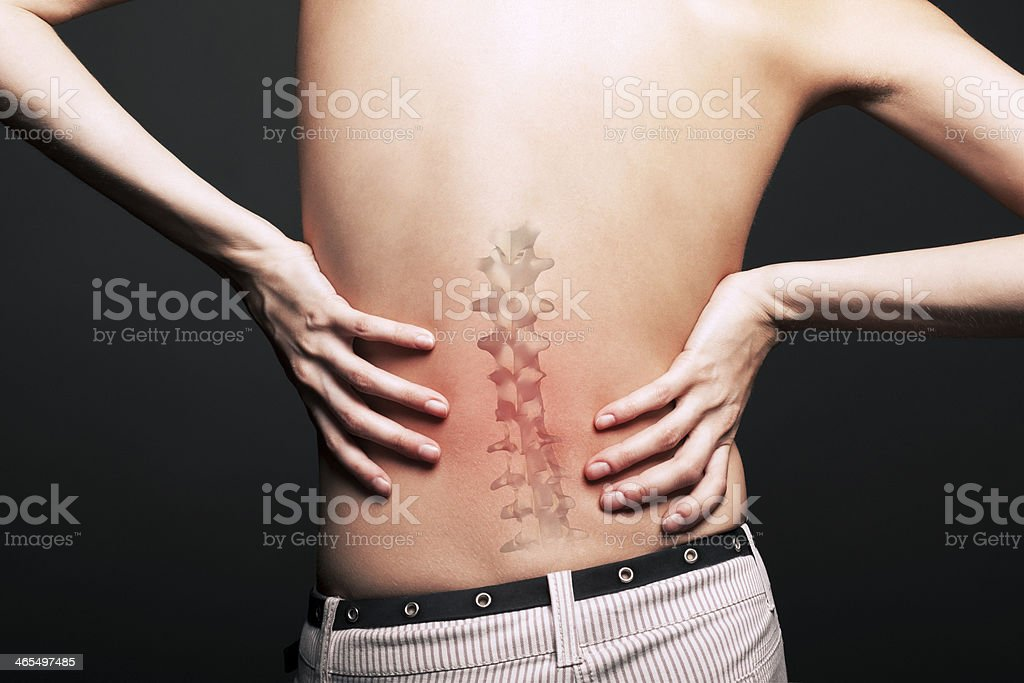 naked young woman with pain in a waist royalty-free stock photo
