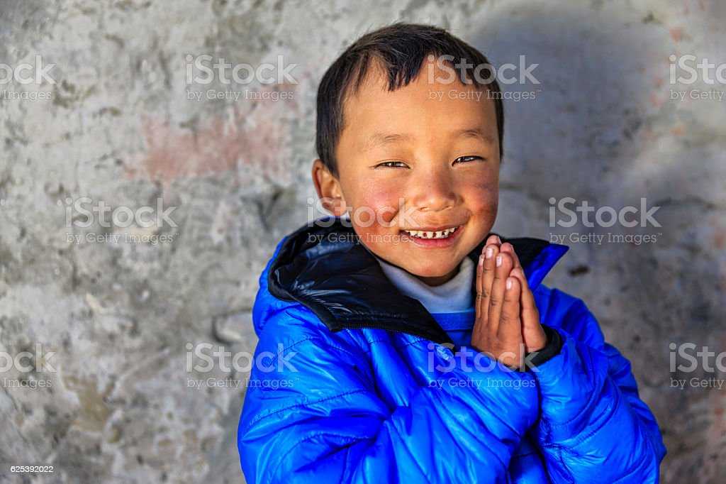 Namaste! - portrait of young Sherpa boy in Everest Region stock photo