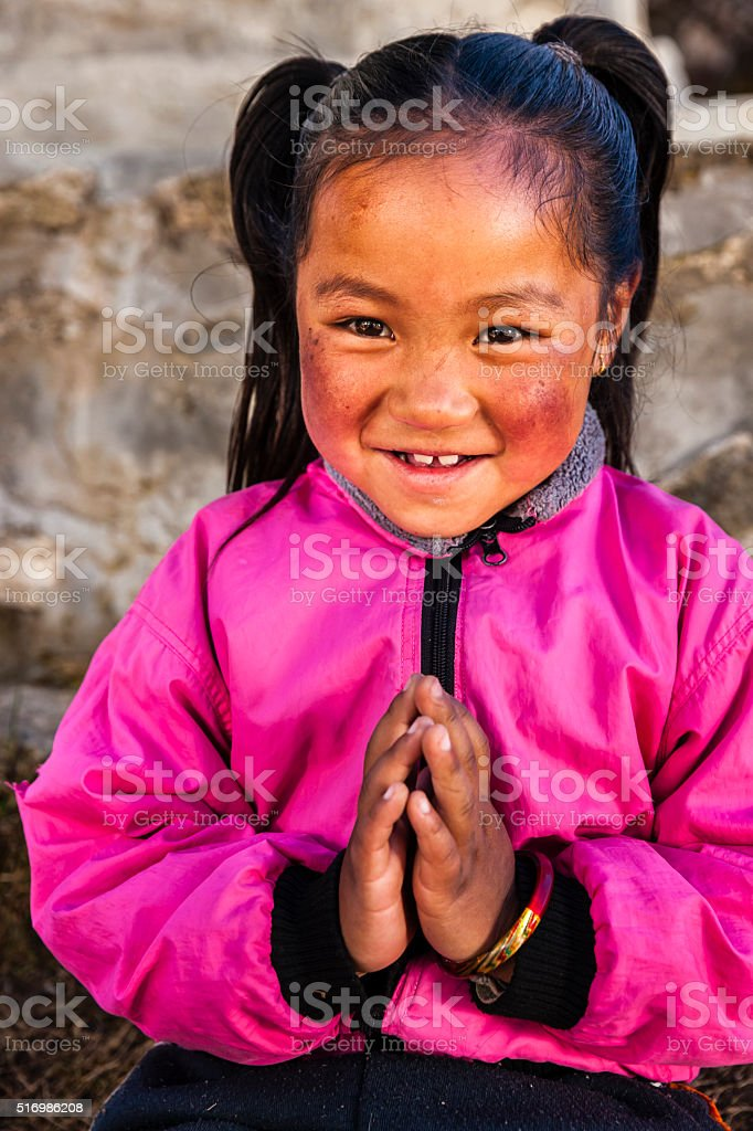 Namaste! - portrait of young Sherpa girl in Everest Region stock photo