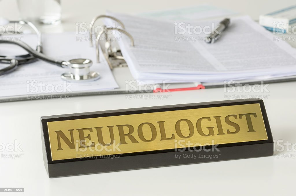 Name plate on a desk with the engraving Neurologist stock photo