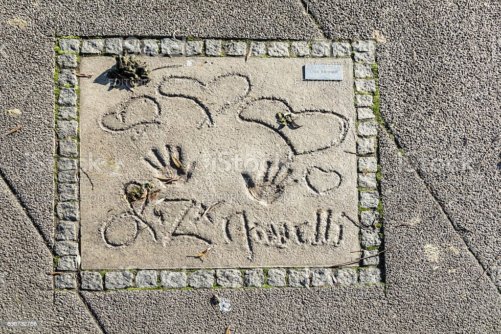 names and hand prints at the Munich walk of stars stock photo