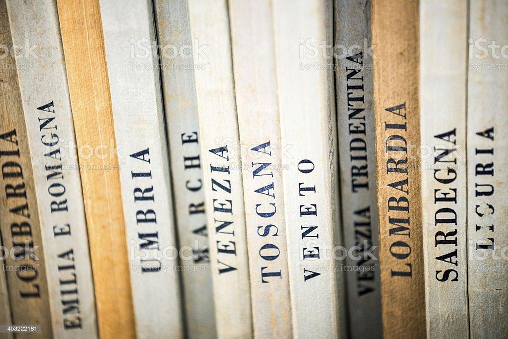 Names of Italian regions on old books stock photo