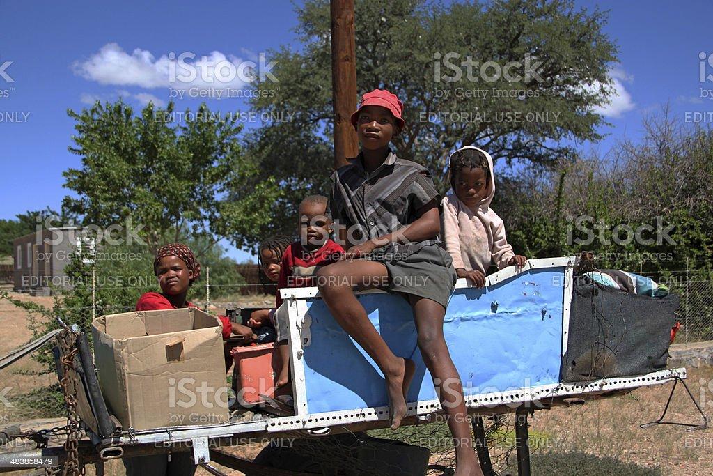 Namibia: Children on a horse-drawn wagon stock photo