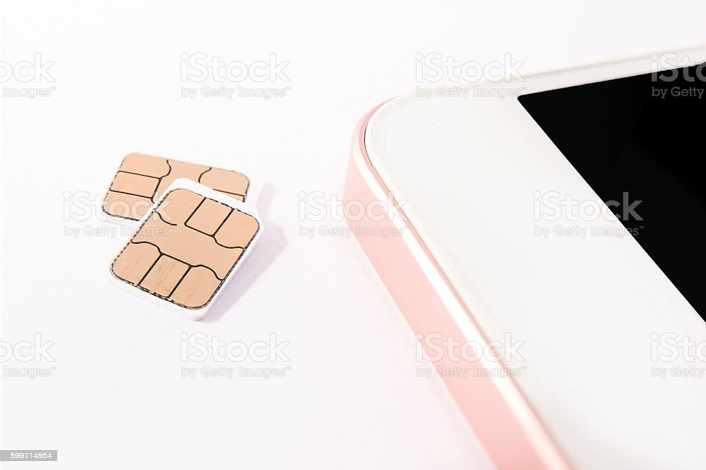 nano sim card and smart phone stock photo