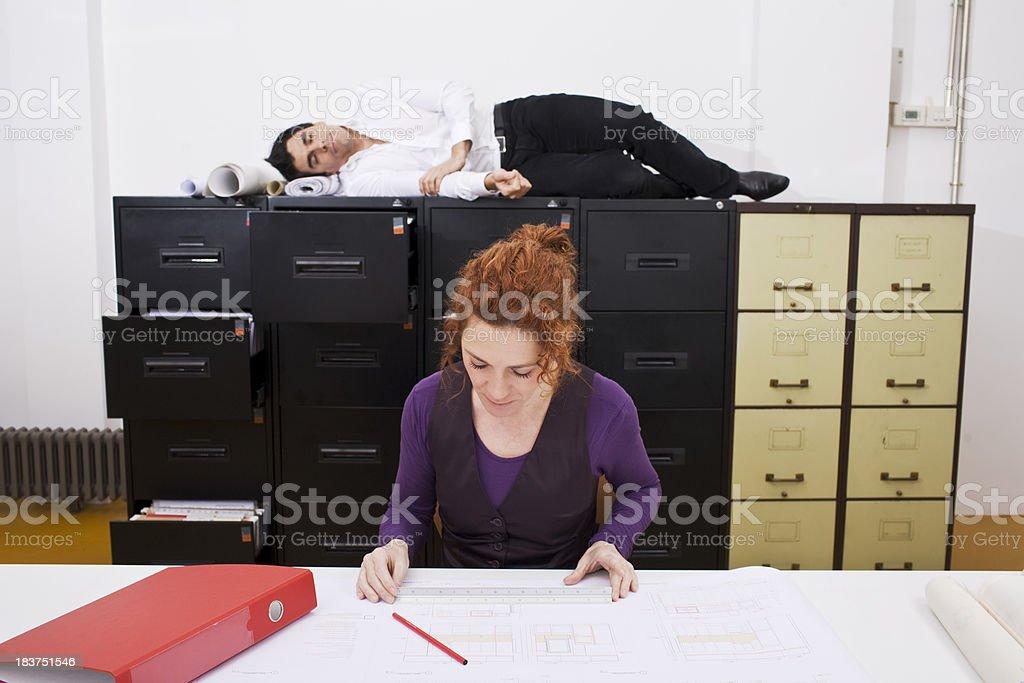 Nap behind working boss _ horizontal. royalty-free stock photo