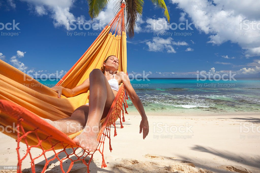 nap in hammock stock photo
