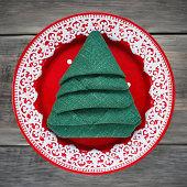 Napkin folded in the shape of a Christmas tree