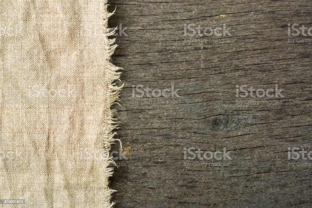 Napkin on an old wooden table in gray. A lot of empty space. stock photo