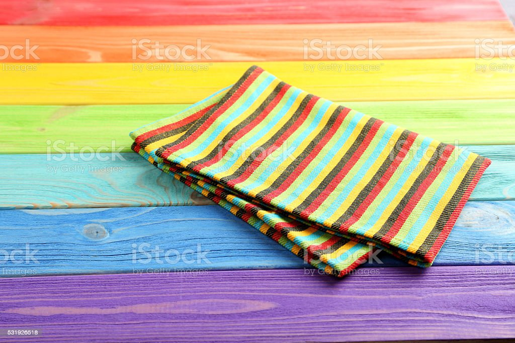 Napkin on colorful wooden table, close up stock photo