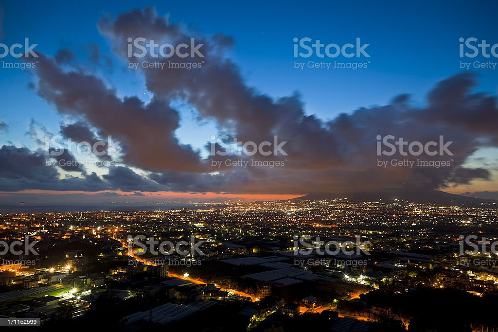 Naples By Night With Volcano Vesuvio Behind the Clouds royalty-free stock photo
