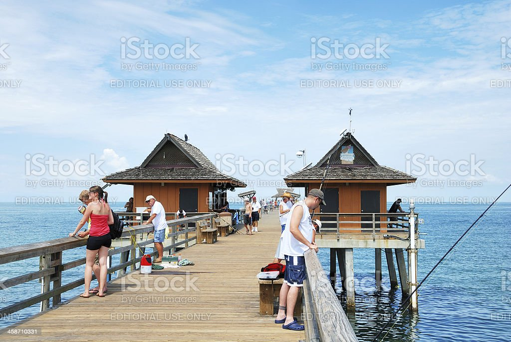 Naples Florida USA pier with people fishing and relaxing. stock photo