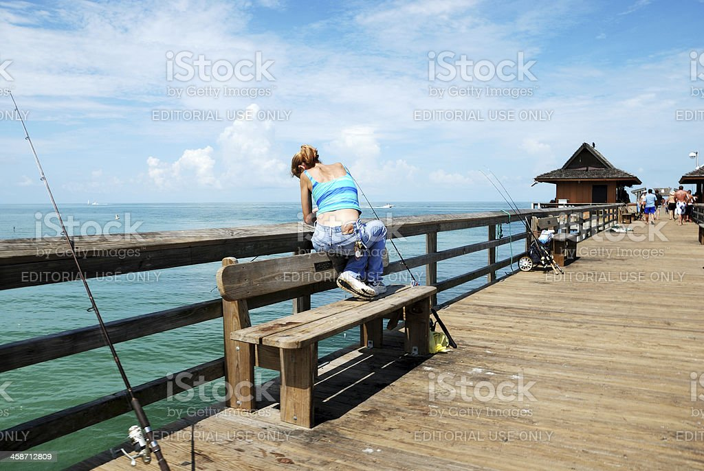 Naples Florida USA pier with people fishing stock photo