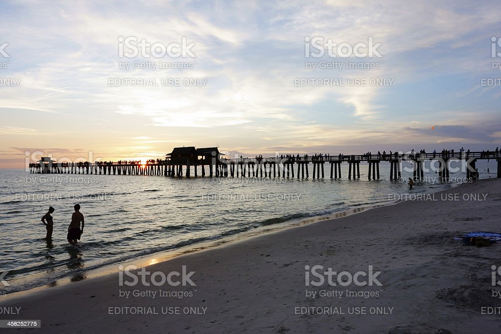 Naples pier at sunset stock photo