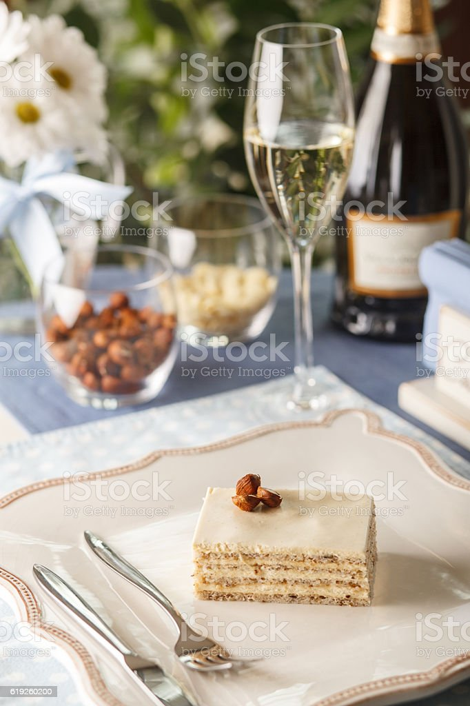 Napoleon cake with nuts and champagne stock photo
