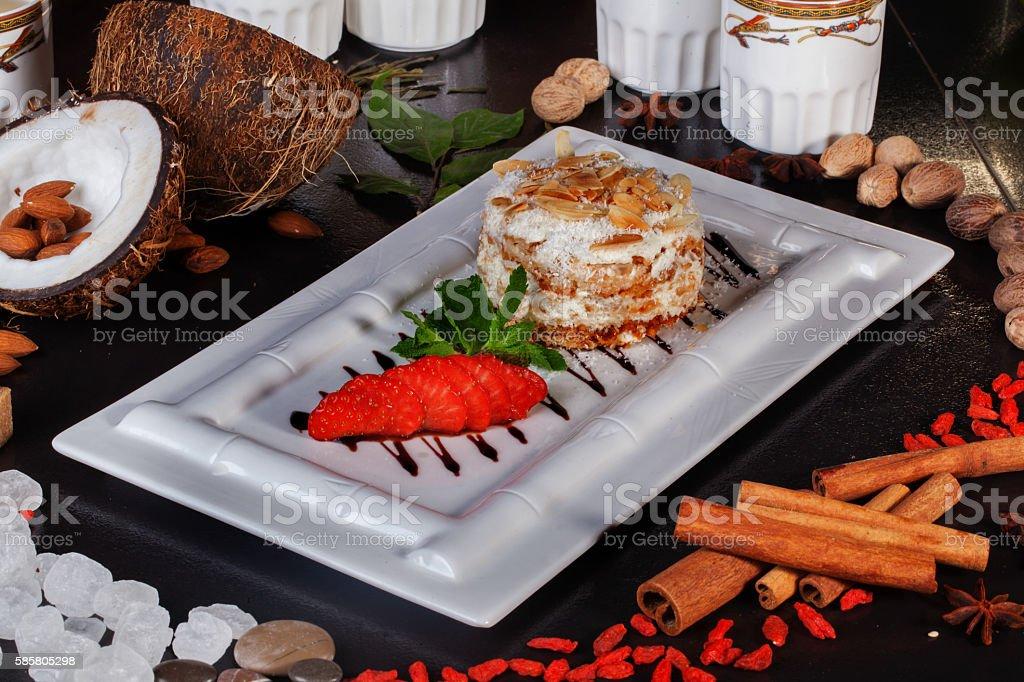 napoleon layered cake with almonds Still Life restaurant, strawberry, sauce stock photo