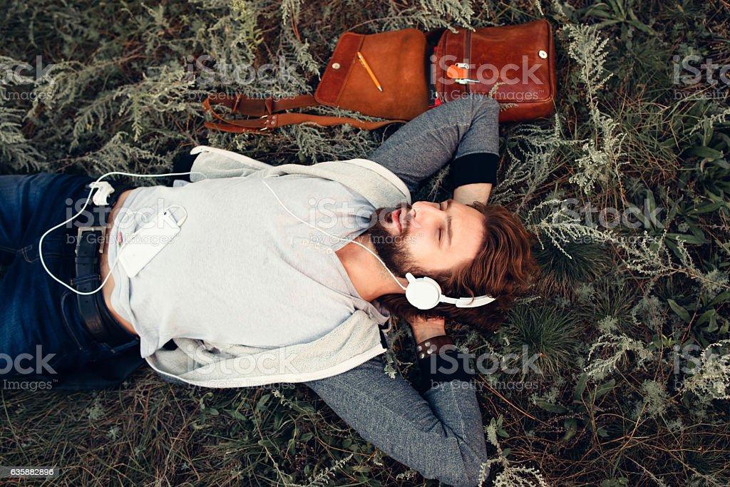 Napping at nature young man top view stock photo