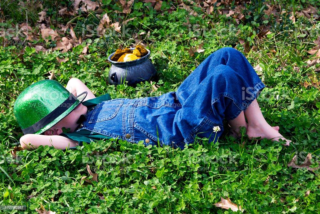 Napping Leprechaun stock photo