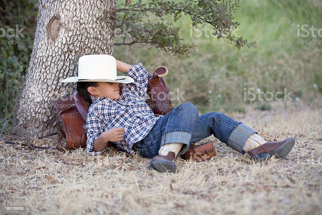 Napping Little Cowboy royalty-free stock photo