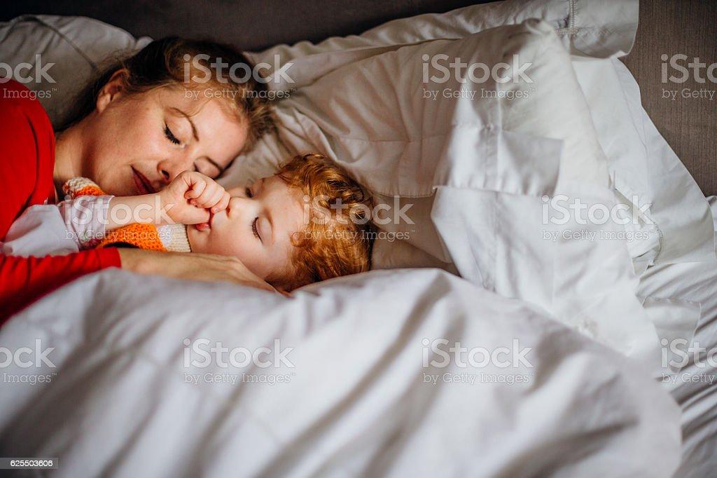 Naptime with Mum stock photo