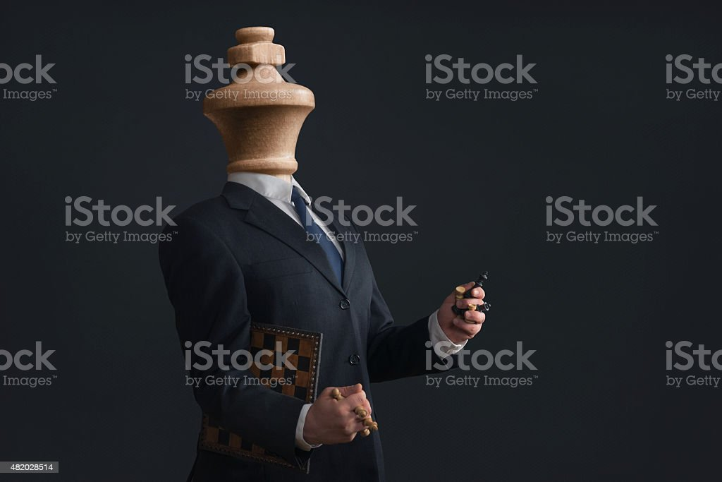 Narcissist without head and with pawns in the hands stock photo