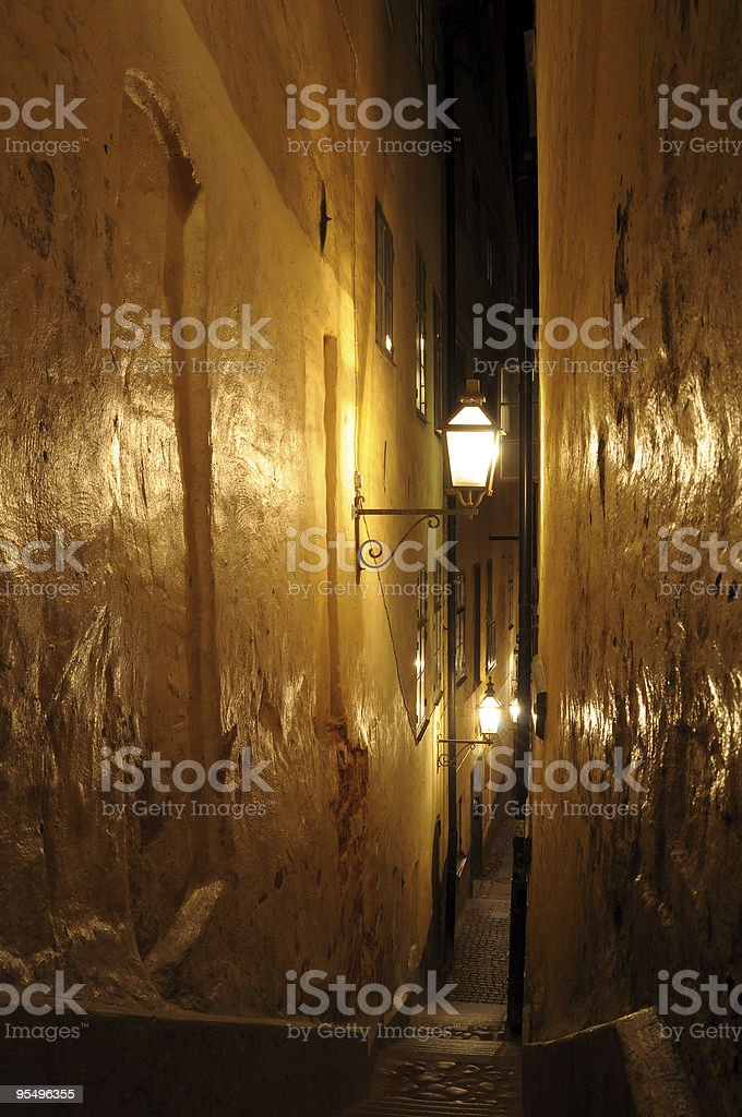 Narrow alley at night in Stockholm royalty-free stock photo