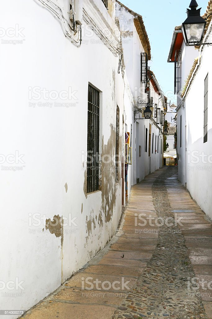 Narrow alley in Cordoba, Spain stock photo