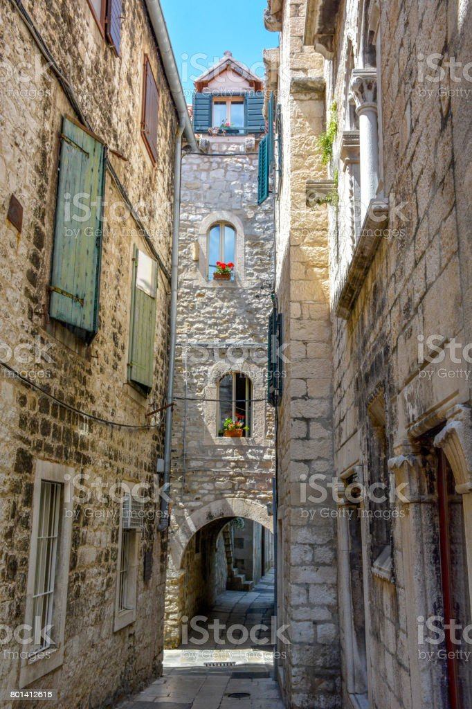 Narrow and empty alley or pedestrian street at the Old Town in Split, Croatia stock photo