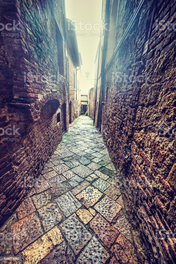 narrow backstreet in Tuscany stock photo