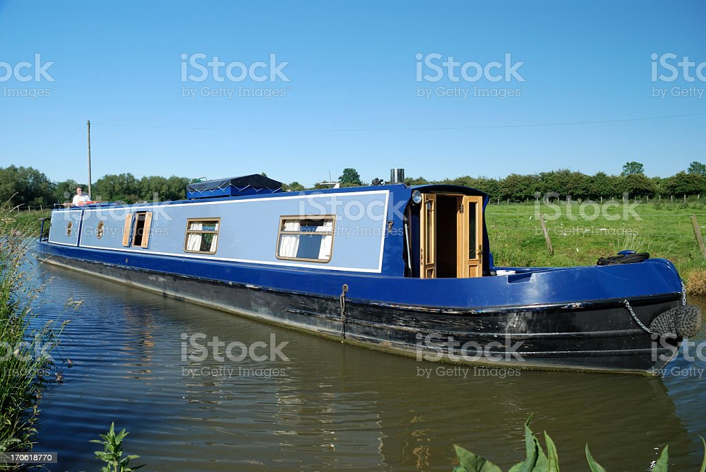 Narrow boat cruising on oxford canal stock photo