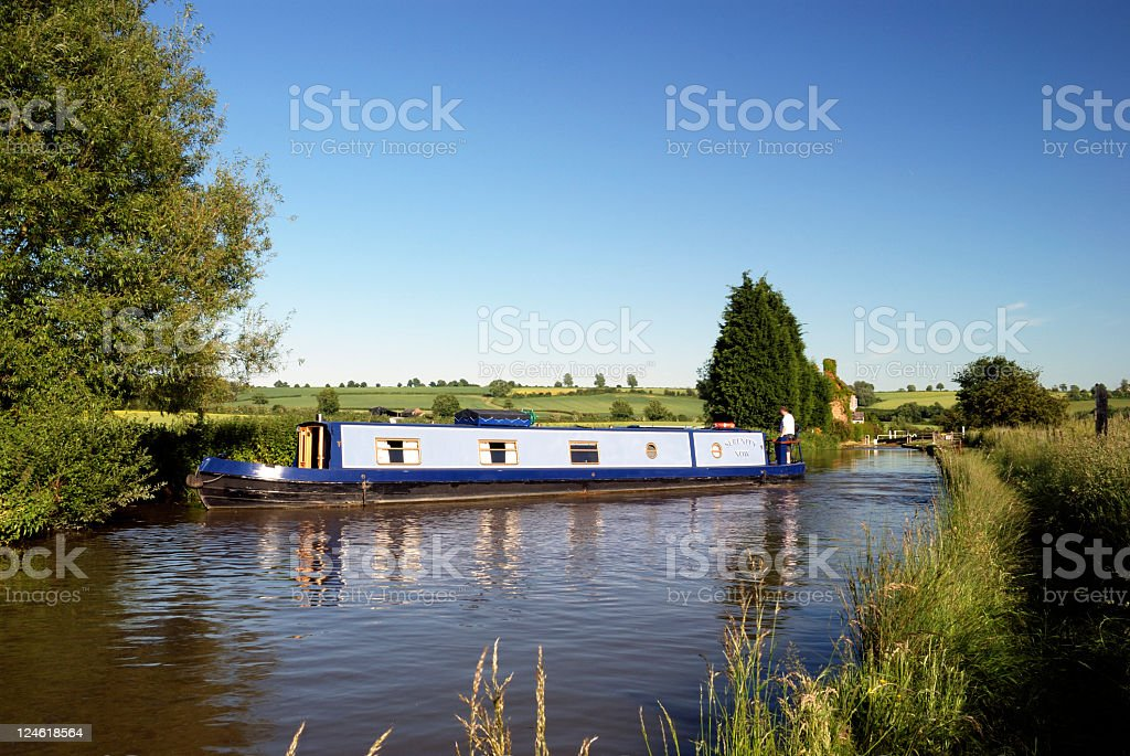 Narrow boat turning on Oxford canal Oxfordshire England stock photo