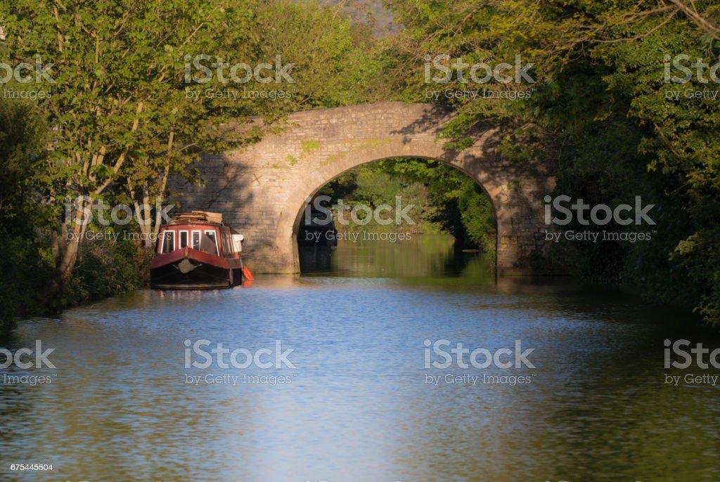 Narrow boats on River Avon with stone bridge stock photo