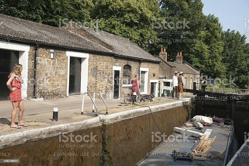 Narrow boats passes through Old Ford Lock, London. royalty-free stock photo